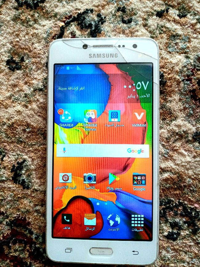 Samsug galaxy grand prim avec sharger